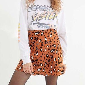 Urban Outfitters leopard satin swingy mini skirt